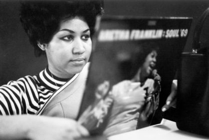 "NEW YORK - JANUARY 09: Soul singer Aretha Franklin reviews a copy of her album ""Aretha Franklin - Soul '69"" at Atlantic Records studios on January 9, 1969 in New York City, New York. (Photo by Michael Ochs Archives/Getty Images)"